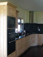 Ash Kitchen Featuring Granite Surfaces